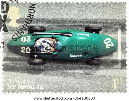 UNITED KINGDOM - CIRCA 2007: A used postage stamp printed in Britain celebrating the 50th Anniversary of the British Grand Prix showing Stirling Moss in a 1957 Vanwall - stock photo