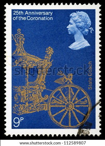 UNITED KINGDOM - CIRCA 1978: British Postage Stamp celebrating the 25th Anniversary of the Coronation of Queen Elizabeth 2nd, showing the State Coach, circa 1978 - stock photo