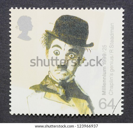 UNITED KINGDOM � CIRCA 1999: postage stamp printed in United Kingdom showing an image of Charles Chaplin, circa 1999. - stock photo