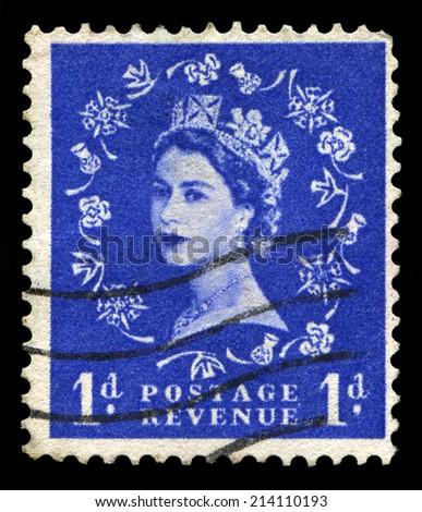 UNITED KINGDOM, CIRCA 1950s: A vintage British postage stamp depicting a portrait of Queen Elizabeth II, circa 1950s. - stock photo