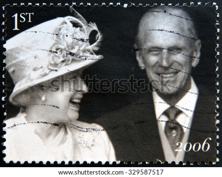 UNITED KINGDOM - CIRCA 2006: Stamp printed in UK shows Queen Elizabeth II and the Duke of Edinburgh Prince Philip leave St Pauls Cathedral, the Diamond Wedding Anniversary, circa 2006 - stock photo