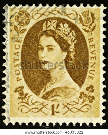 UNITED KINGDOM - CIRCA 1952 to 1965: An English One Shilling Brown Used Postage Stamp showing Portrait of Queen Elizabeth 2nd, circa 1952 to 1965 - stock photo