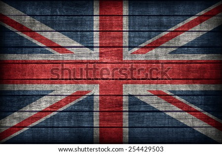 United Kingdom flag pattern on wooden board texture ,retro vintage style - stock photo
