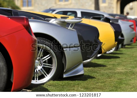UNITED KINGDOM - SEPTEMBER 13: Selection of Supercars on display at the United Kingdom Concours d'elegance Classic Car Expo at Windsor Castle on September 13, 2012 in Windsor, United Kingdom. - stock photo