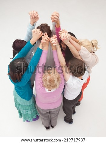 United - many people joining hands together as a symbol of unity. - stock photo