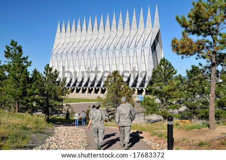 United States Air Force Academy Chapel with cadets/servicemen walking in foreground - stock photo