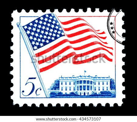 UNITED STATES AMERICA - CIRCA 1970: A postage stamp printed in the USA of the American flag, circa 1970 - stock photo