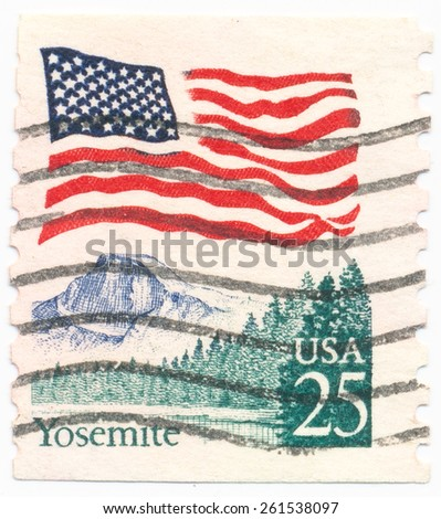 UNITED STATES - CIRCA 1988: A postage stamp printed in the United States, features waving US flag and Yosemite National Park, circa 1988 - stock photo