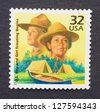 UNITED STATES -Â?Â? CIRCA 1998: A postage stamp printed in USA showing an image of a commemorative of the start of the Boy Scouts and Girls Scouts, circa 1998. - stock photo