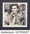 UNITED STATES - CIRCA 1998: A postage stamp printed in USA showing an image of a mother with her children during the Great Depression, circa 1998. - stock photo