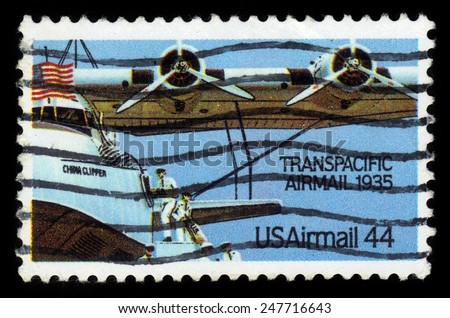 UNITED STATES - CIRCA 1985: A stamp printed in the United States, shows aircraft Martin M-130 China Clipper, Transpacific Airmail 1935, circa 1985 - stock photo