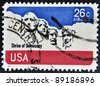 UNITED STATES - CIRCA 1974:A stamp printed in USA shows image of the Mount Rushmore National Memorial is a sculpture carved into the granite face of Mount Rushmore near Keystone, circa 1974. - stock photo