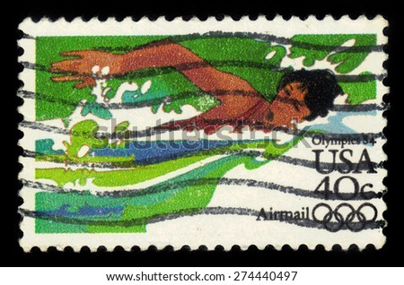 UNITED STATES - CIRCA 1984: a stamp printed in USA, shows swimming, 1984 Summer Olympics issue, circa 1984 - stock photo
