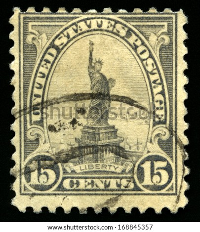 UNITED STATES - CIRCA 1920s: Vintage US Postage Stamp portraying the iconic Statue of Liberty in New York, circa 1920s. - stock photo