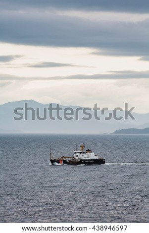 United States Coast Guard buoy tender in the Alaskan Inner Passage - stock photo
