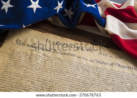 United States Declartion of Independence with vintage flag.  July 4th. - stock photo