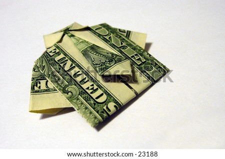 United States dollar bills folded origami style into a shirt and tie - stock photo