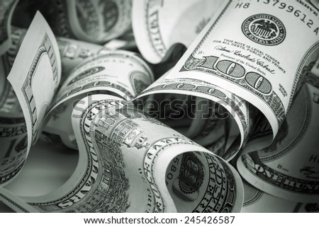 United States dollars. Pile of hundred USD banknotes. Green toned photo with selective focus - stock photo