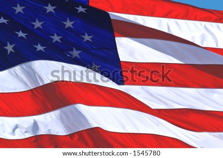 United States flag blowing in the wind - stock photo