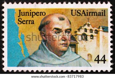 UNITED STATES OF AMERICA - CIRCA 1985: a stamp printed in the United States of America shows Fr. Junipero Serra, California Missionary and San Gabriel Mission, California, circa 1985 - stock photo