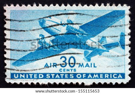 UNITED STATES OF AMERICA - CIRCA 1941: a stamp printed in the United States of America shows Twin-motored transport plane, circa 1941 - stock photo