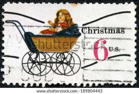 UNITED STATES OF AMERICA - CIRCA 1970: a stamp printed in the USA shows Doll Carriage, Toy, Christmas, circa 1970 - stock photo