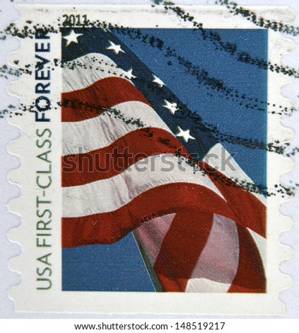 UNITED STATES OF AMERICA - CIRCA 2011: A stamp printed in the USA shows Flag on the sky, circa 2011  - stock photo