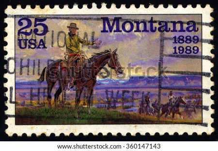 """UNITED STATES OF AMERICA - CIRCA 1989: A stamp printed in USA dedicated to the 100th Anniversary of the State of Montana shows a picture of """"The Horseman"""" by Charles M. Russell, circa 1989 - stock photo"""