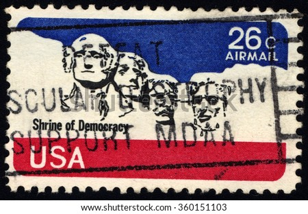 UNITED STATES OF AMERICA - CIRCA 1980: A stamp printed in USA shows National Memorial Stone Sculptures of George Washington, Thomas Jefferson, Theodore Roosevelt and Abraham Lincoln, circa 1980 - stock photo