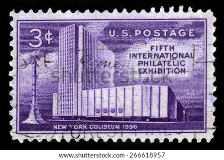 UNITED STATES OF AMERICA - CIRCA 1956: A stamp printed in USA shows New York Coliseum and Columbus Monument, fifth international philatelic exhibition issue, circa 1956 - stock photo