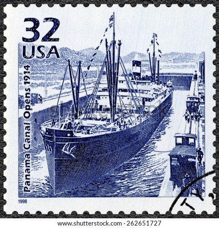 UNITED STATES OF AMERICA - CIRCA 1998: A stamp printed in USA shows Panama Canal opens, 1914, series Celebrate the Century, 1910s, circa 1998 - stock photo