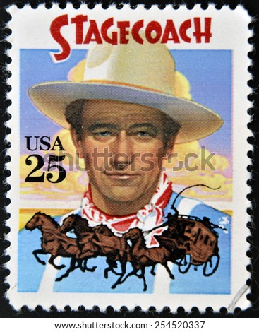 UNITED STATES OF AMERICA - CIRCA 1990: A stamp printed in USA shows  portrait of American actor John Wayne as The Ringo Kid in Stagecoach Western film, circa 1990. - stock photo