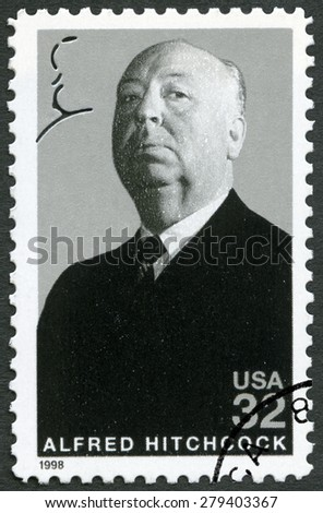 UNITED STATES OF AMERICA - CIRCA 1998: A stamp printed in USA shows portrait of Sir Alfred Joseph Hitchcock (1899-1980), series Legends of Hollywood, circa 1998 - stock photo