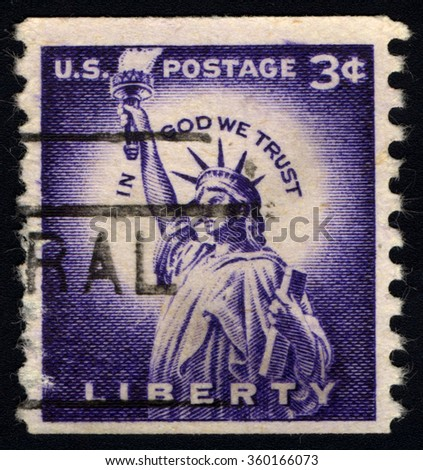 "UNITED STATES OF AMERICA - CIRCA 1954: A stamp printed in USA shows Statue of Liberty, with inscription ""in God We Trust"", Liberty Issue, circa 1954 - stock photo"