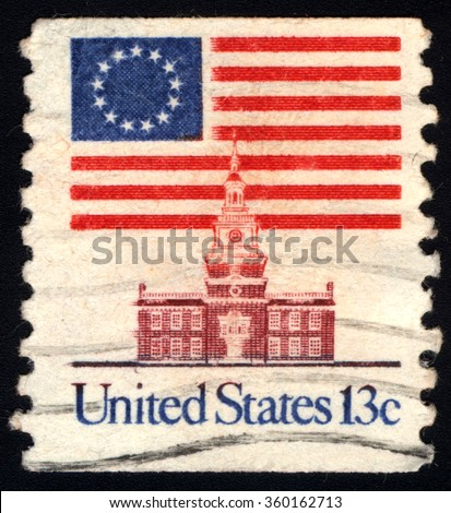 UNITED STATES OF AMERICA - CIRCA 1980: A stamp printed in USA shows The National Flag of the United States of America, circa 1980. - stock photo