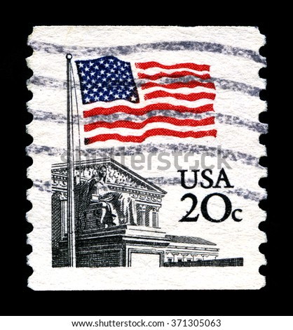 UNITED STATES OF AMERICA - CIRCA 1988: A used postage stamp from the United States of America, portraying and illustration of the American Flag and the Supreme Court, circa 1988. - stock photo