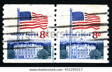 UNITED STATES OF AMERICA - CIRCA 1971: A used postage stamp from the USA depicting an illustration of the White House and the American flag, circa 1971. - stock photo