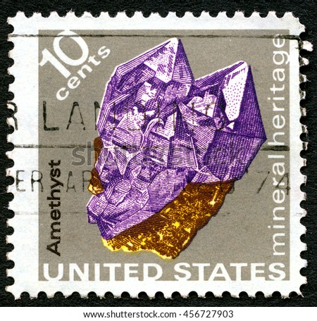 UNITED STATES OF AMERICA - CIRCA 1974: A used postage stamp from the USA portraying an illustration of the precious mineral stone Amethyst, circa 1974. - stock photo