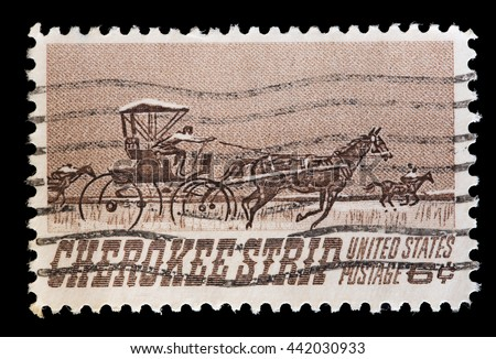 UNITED STATES OF AMERICA - CIRCA 1968: A used postage stamp printed in United States shows a stagecoach drawn by horses along the Cherokee Strip of Kansas, circa 1968 - stock photo