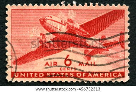 UNITED STATES OF AMERICA - CIRCA 1943: A used US Air Mail postage stamp depicting an illustration of a vintage transport plane, circa 1943. - stock photo