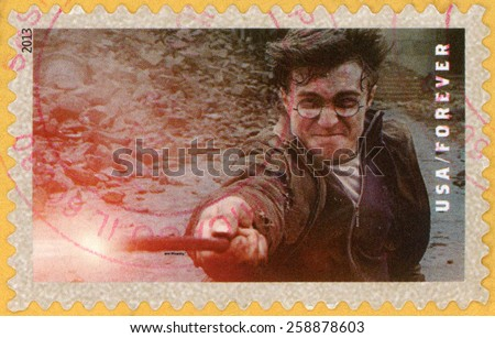 UNITED STATES OF AMERICA - CIRCA 2013: forever post stamp printed in USA shows Daniel Radcliffe as Harry Potter casting spell with magic wand; scenes from Harry Potter movies; Scott 4842; circa 2013 - stock photo