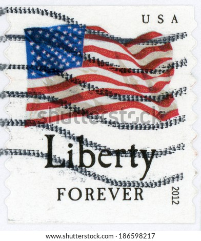 UNITED STATES OF AMERICA - CIRCA 2012: post stamp printed in US shows waving USA flag on white background and liberty forever, red blue, circa 2012 - stock photo