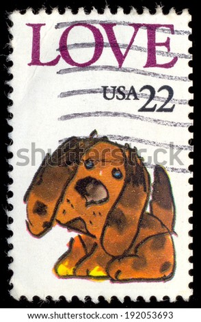 UNITED STATES OF AMERICA - CIRCA 1986: Postage stamp printed in United State of America with caricature image of a brown puppy with the word love. us - stock photo