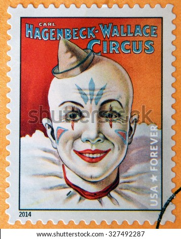 UNITED STATES OF AMERICA - CIRCA 2014: stamp printed in USA shows head of smiling clown with hat in his hand; Carl Hagenbeck-Wallace circus; circus vintage posters, circa 2014 - stock photo