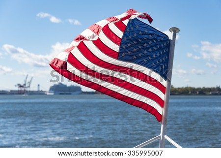 United States of America flag flying or waving in boat or cruise in the Hudson River.  Beautiful symbol of freedom in New York city. - stock photo