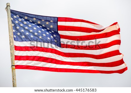 United States of America flag. Image of the american flag flying on the wind. - stock photo