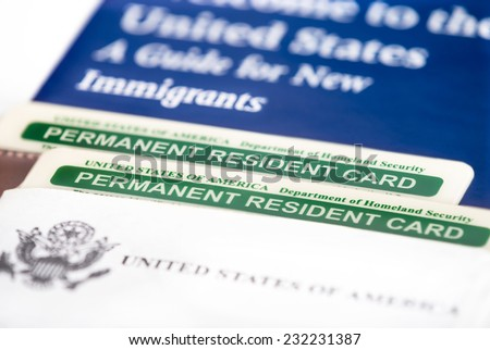 United States of America permanent resident cards, green card. Immigration concept. Closeup with shallow depth of field. - stock photo