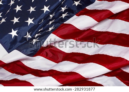 United States Of America Red White Blue Flag waving in the wind and sunlight closeup - stock photo