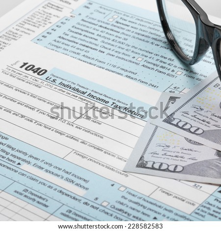United States of America Tax Form 1040 with glasses - stock photo