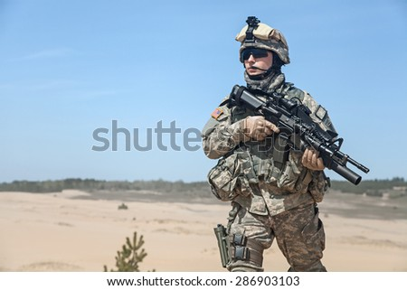 United States paratrooper airborne infantry in the desert - stock photo